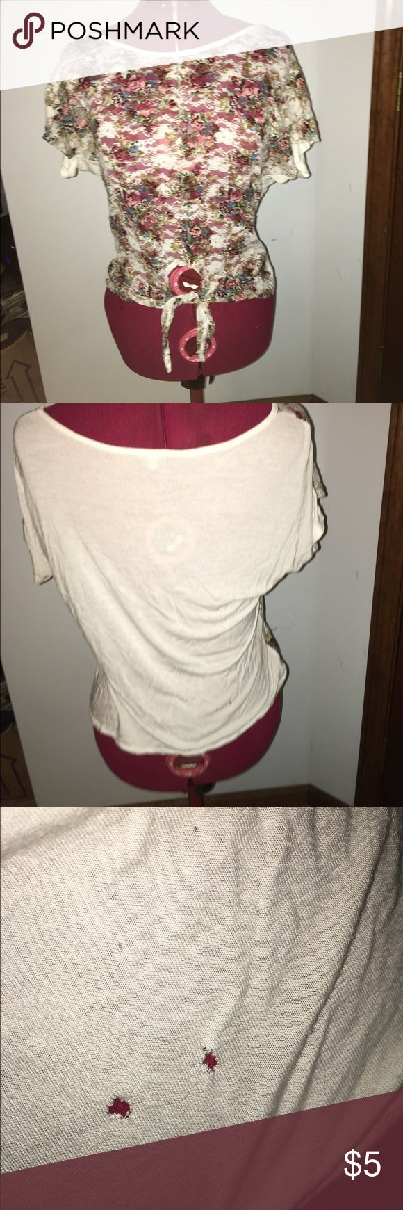 Floral Lace Top Floral lace located in the front part of the shirt, see through. The back part of the shirt is all white. There are two small holes on the lower part of the back. Charlotte Russe Tops Crop Tops