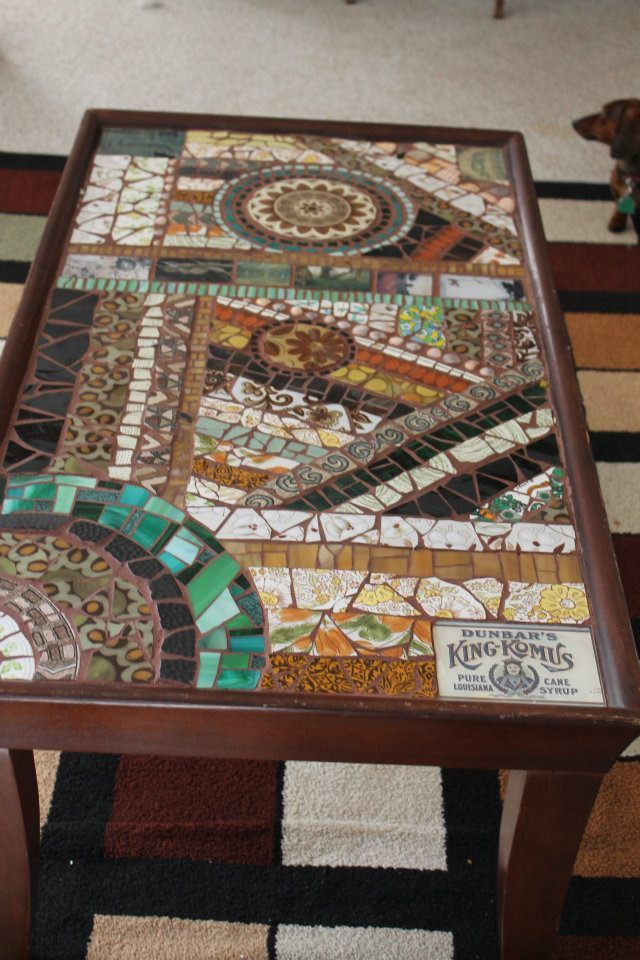 mosaic table - many many plates found in thrift shops, stained glass, seashells, an antiques postcard
