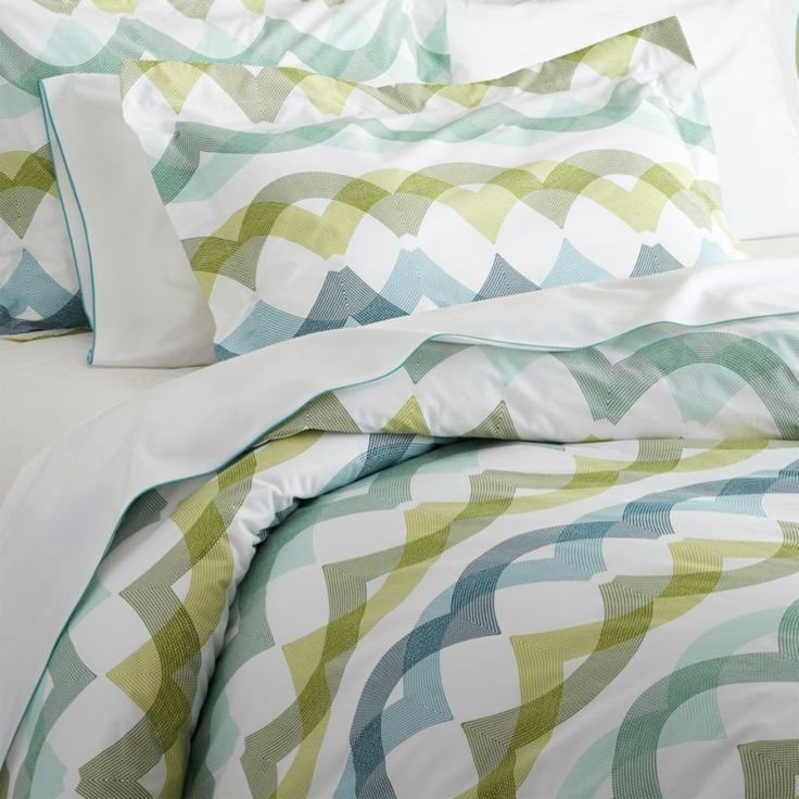 Italian-made linens overlap translucent waves of teal, citron and green creating a sea of soothing color in a vibrant pattern that signals casual and contemporary. Duvet has a hidden-button closure and interior fabric ties to stabilize duvet insert.  Duvet inserts also available. 100% cotton percale200-thread-countMachine wash cold; tumble dry low; warm iron as neededDo not bleachHidden button closure and interior fabric tiesMade in Italy.