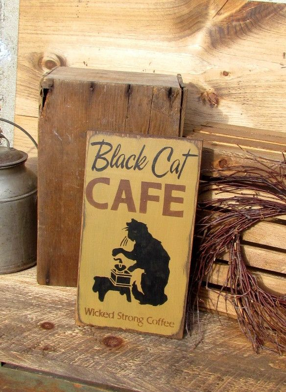 """This wooden sign is made from local NH pine, and measures Approx 14""""Tall x 7.5""""Wide It reads """"Black Cat Cafe wicked strong coffee"""". The front is painted a Mustard Yellow then distressed, the back is s"""