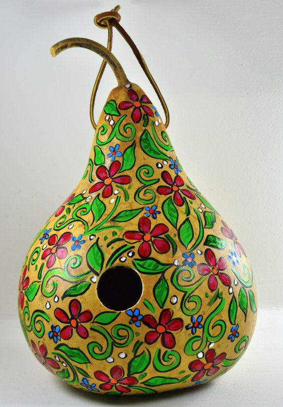 Gourd Birdhouse - Nothing says Springtime like a hand painted gourd birdhouse for your garden or home decor. Not only is this gourd a colorful addition to your decor, but it is functional... especially for the birds! Your decor becomes their decor as they move in and make a nest. . It is a good size for a Titmouse, Nuthatch, or Wren.  Here are some birdhouse specifics: This birdhouse measures about 10 tall and 7 round. The opening for the bird is 1.5 It is hand painted in acrylics. Each…