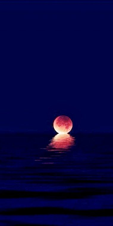 Lunar Eclipse melting into the Ocean...