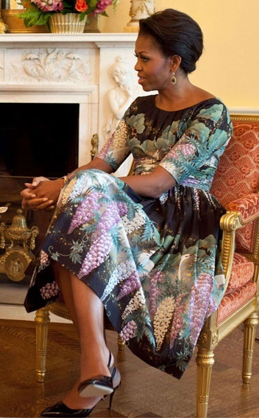 Mrs. Obama because she's not afraid to pull out a dress from two years ago and wear it out in public again.