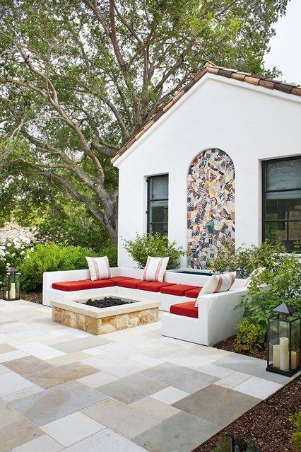 Outdoor Garden - Outdoor Room Design And Ideas  An inset seating niche in the formal courtyard garden at the front of the house by David Bentheim is paved in a variety of French stones from Exquisite Surfaces.