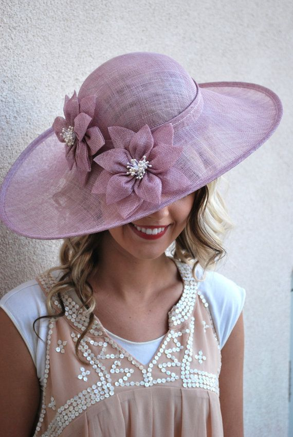 Sinamay Derby Hat with flower design and adjustable headband.  Perfect Piece for a wedding, tea party or any other special occasion. -Available in
