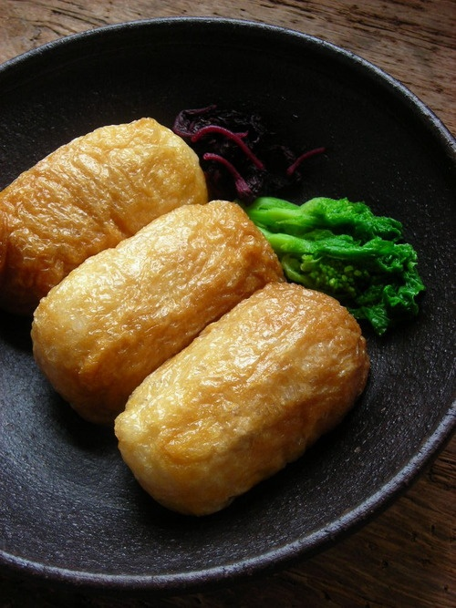 Inarizushi (稲荷寿司) is a pouch of fried tofu typically filled with sushi rice alone.