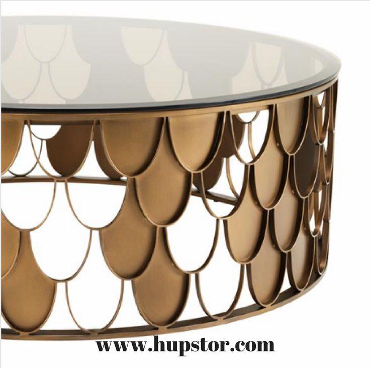 Table basse L'indiscret avec son esprit année 30 d'un diamètre de 110 cm en acier finition cuivre antique et son plateau en verre fumée couleur fauve sera .....