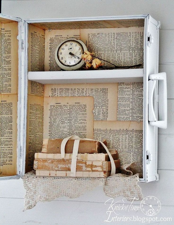 Cover an old skate trunk's dents with paint & book pages. You'll love the vintage mirror on the outside.