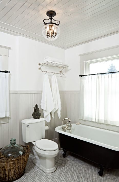 Vintage bathroom with glossy gray beadboard walls & ceiling, cast iron claw foot tub, white carrara marble hex tiles floor and polished nickel towel rack. Source: Jessica Helgerson Interior Design