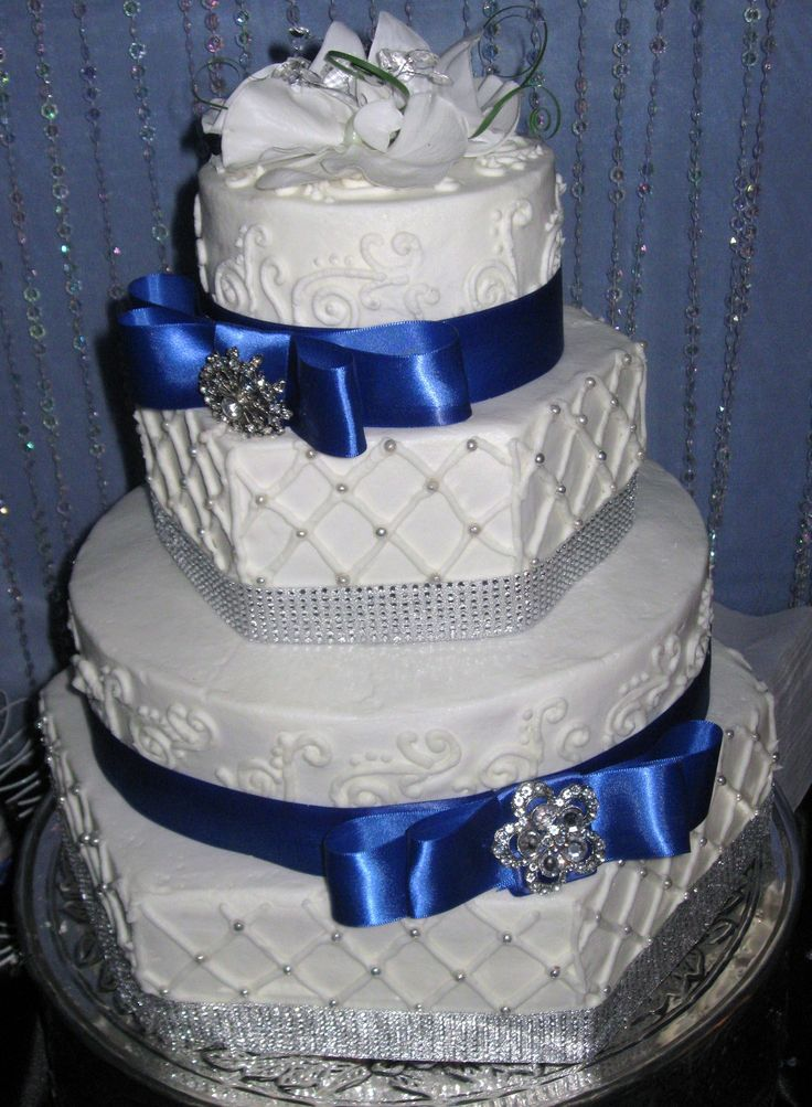 Hexagon royal blue wedding cake - Hexagon and round cakes with rhinestone accents and satin ribbon
