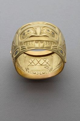 "Who made it to the opening of Haislakala: Spoken from the Heart Lyle Wilson Solo Exhibition this weekend? Thank you for all your sharing + support online! Today we're featuring: Qolun (Beaver) Bracelet • Lyle Wilson • Haisla Nation. ""This bracelet continues the theme of my roots in the Beaver Clan, as the main character is a Beaver. Since my present Eagle Clan was kind enough to adopt me, I really couldn't leave them out of the 'story,' and so an Eagle is around the back as the small face…"