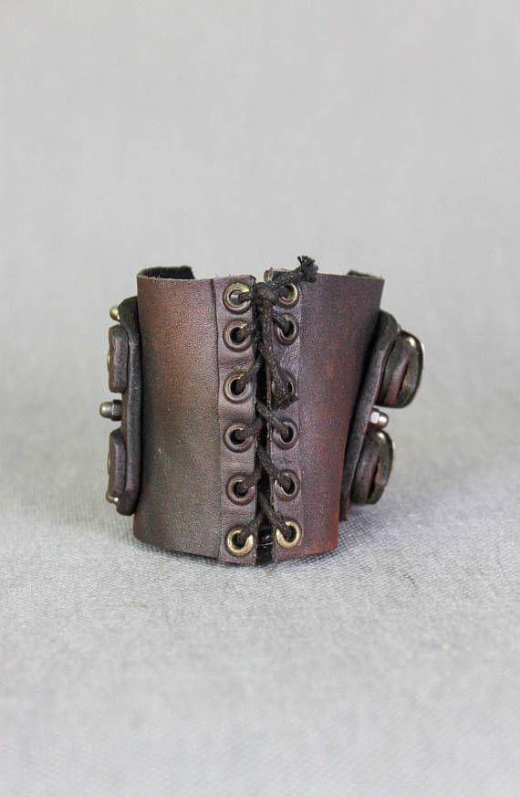 Rustic Mens Bracelet - Vintage Military Wrist Band - Post Apocalyptic Bracelet - Leather Vambrace - Military Wrist Band - Army Mens Bracelet  Designer of the project is Viola Sychowska, founder of Wasted Couture collective. Leather work is made by Szpaku, member of Wasted Couture collective.  Post apocalyptic bracelet is handmade from leather. The inspiration cames from postapocalyptic warriors. It is prefect to express your passions in daily routine, but also good for LARP games, movie or…