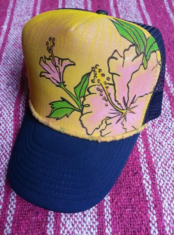 Hand Painted Trucker Hat Original Artwork Acrylic Paint Hawaiian Flower Yellow Pink Green Navy Blue Adjustable Back Strap Adult by Roupoli. $35.00, via Etsy.