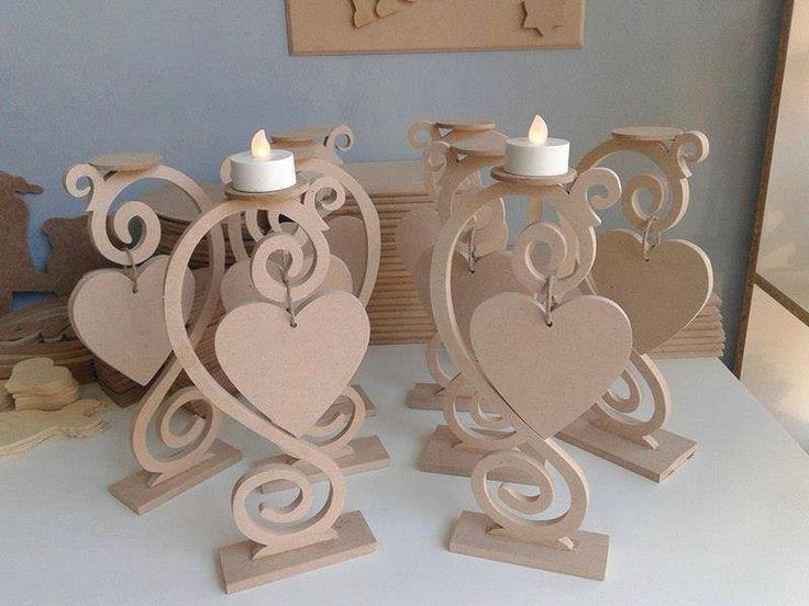 Ξυλινα κηροπηγια με διακοσμητικη καρδια απο MDF 6'' στα 27εκ υψος. Στην θεση της καρδιας μπορουν να μπουν μονογραμματα για τον στολισμο τραπεζιου γαμου και βαπτισεως.  Μια ομορφη ιδεα για την διακοσμηση του εσωτερικου χωρου σας αλλα και ενα ομορφο δωρο σε ενα φιλο-φιλη.  Καταλληλο για ζωγραφικη , decoupage και αλλες τεχνικες. #wooden #handmade #gift #candlestick #decoupage #painting #crafting