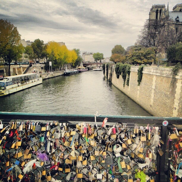 Pont des Art bridge in Paris in front of Norte Dame. You and your loved one write your name on a lock, lock it on the bridge, and throw away the key.