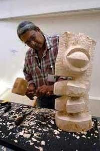Oswald Hussein chisels out a new statue based on one of his mother's stories	LC5451