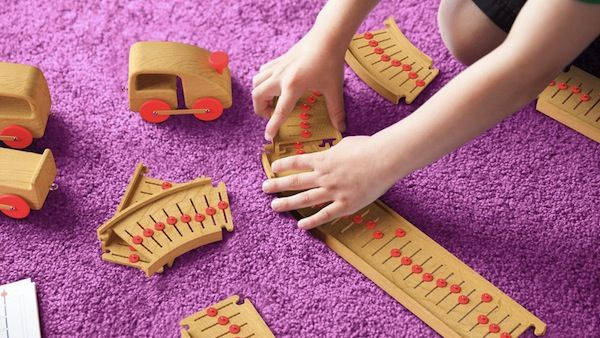Brazil-based industrial designer Ricardo Seola has created a wooden train set for children that also allows them to create music as they play.