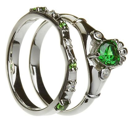 Claddagh Ring--- I would love it if someday I get married that my set of wedding and engagement rings are something like that to honor my Scotland and Ireland heritage along with my birth month stone which is emerald.