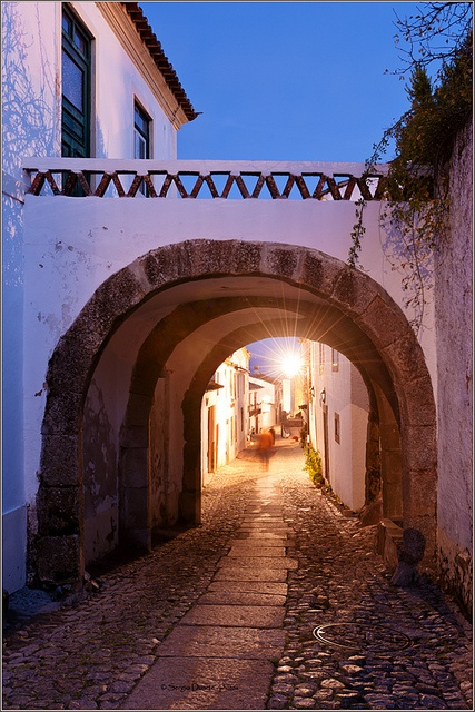 Old street of Marvão with a house with a arch over at dusk. Alentejo, Portugal