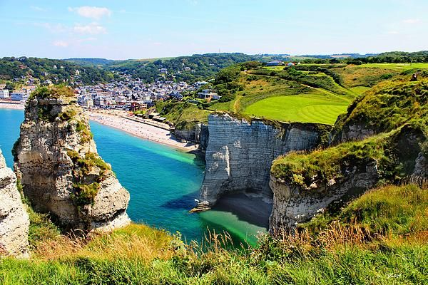 Étretat, Haute-Normandie, France. Étretat is a commune in the Seine-Maritime department in the Haute-Normandie region in northern France, best known for its cliffs, including a famous natural archs (Porte d'Aval, Porte d'Amont, Monet's Rock).  Photographed in France by Julia Apostolova.