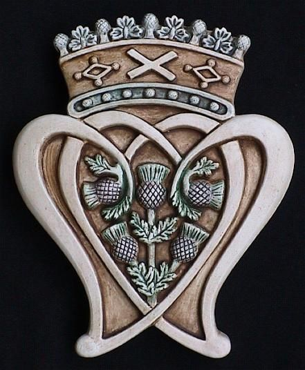Scottish Luckenbooth Emblem-Two hearts entwined and crowned is worn as a symbol of love and troth in Scotland. -- hearts entwined like here, with a C in the center and a crown.