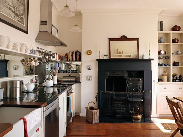 Love the old look the fireplace brings to the kitchen; great focal point.