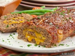Anything stuffed with cheese is bound to be a hit, and that goes for our simply awesome Cheesy Stuffed Meatloaf. Our Test Kitchen really knocked themselves out to make this delicious novel meatloaf recipe look like you fussed; but only you'll know what a cinch it is