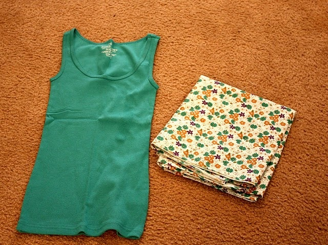 Super simple example of how to make cute little dresses out of a $3 dollar tank top and $3 fabric. Me like.