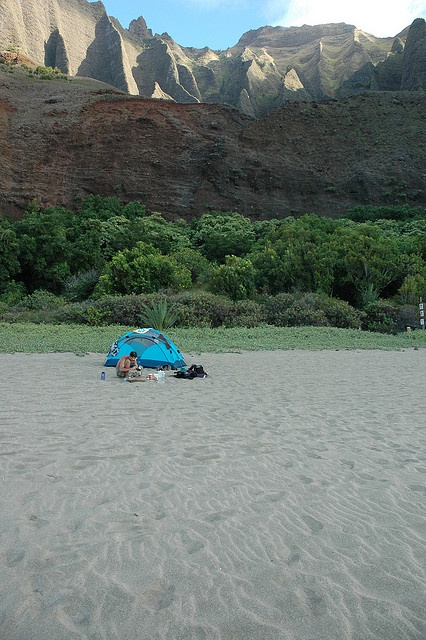 Camping at Kalalau Beach, Na Pali Coast. The background is not photoshopped in folks! It's real.
