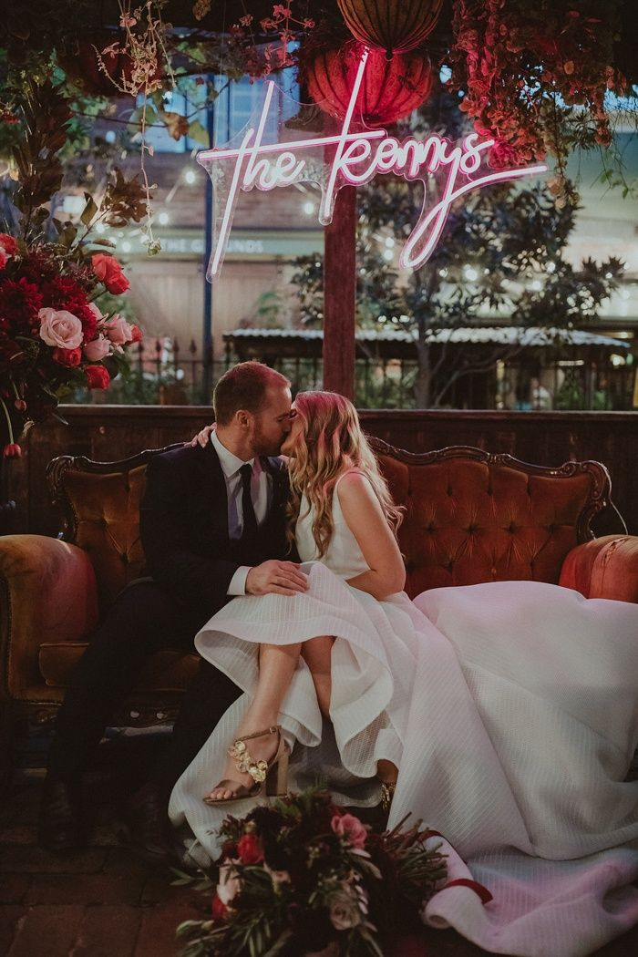 This magical wedding at The Grounds of Alexandria features a hot pink neon sign, a petting zoo, and some of our favorite bridesmaid outfits yet!