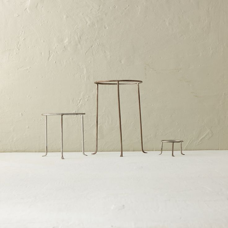 """Designed and crafted exclusively for terrain, these steel plant stands add elevated appeal to indoor and outdoor gardens with a silvery finish and curved feet.- A terrain exclusive- Steel- Indoor or outdoor use- Stand only; trays and containers sold separately- ImportedSmall: 2.5""""H, 3.5"""" diameterMedium: 7""""H, 6.75"""" diameterLarge: 12""""H, 8"""" diameter"""