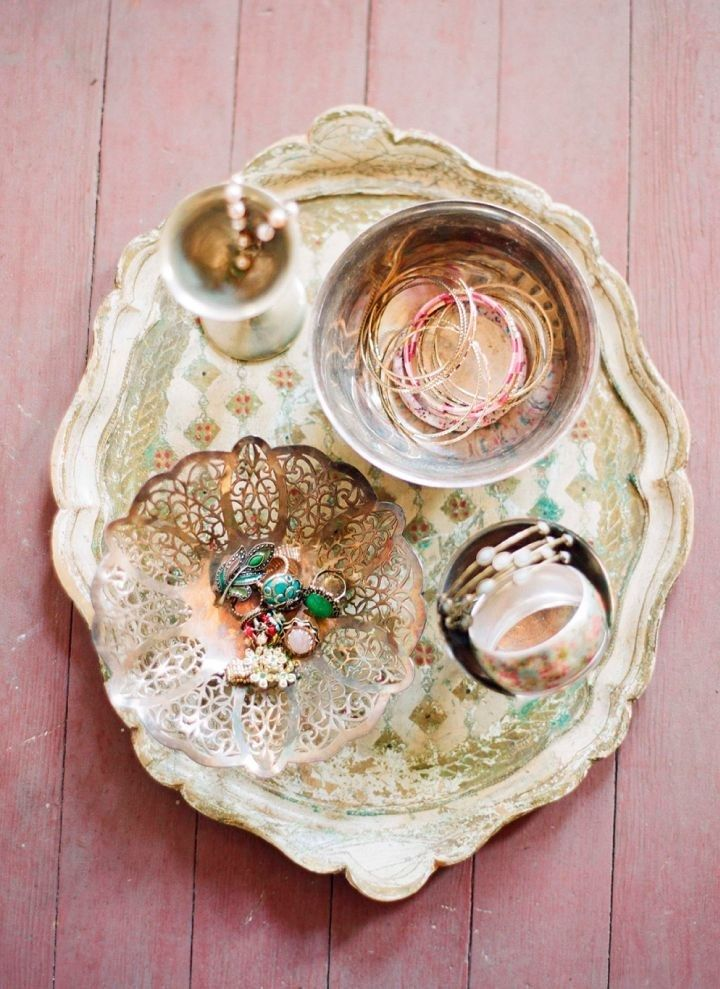 Give an old tray a coat of metallic spray paint and use it to hold your jewelry.