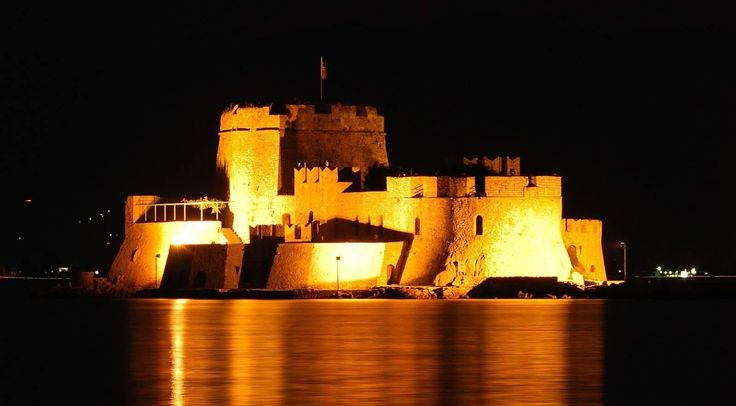 Floodlit Bourtzi Fortress at the entrance of the port of Nafplio