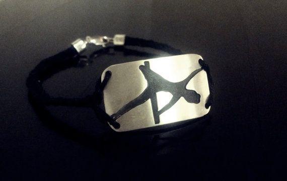 String weaved sterling silver woman's bracelet. Pole dance move description: side hook variation