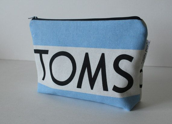 Upcycle your toms flag into a pouch with a zipper!!!! Make yourself, or get on etsy.com for $24