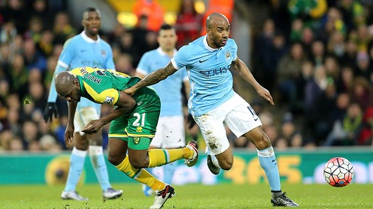 Fabian Delph on the run with the ball during an FA Cup game, Norwich v MCFC