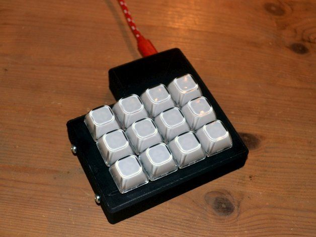 "This is casing designed for a ""DIY keyboard"" USB controller pcb and a 3x4 key mechanical keyboard. The controller can be bought at pcsensor.com. It's called ""DIY-keyboard"" The driver software lets you assign anything to one of the connected keys like a keystroke, a string or a mouse action. Perfect for a small macro keyboard, MMO gaming etc.. The keyboard comes in various sizes from 5 to 25 keys. Search ebay for ""Keyboard Keys Metal Panel SPST Machine Pushbutton Switch"". The transparant…"