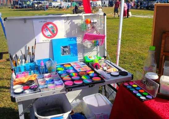 Face painters set up amazing table facepainting for Professional painting supplies