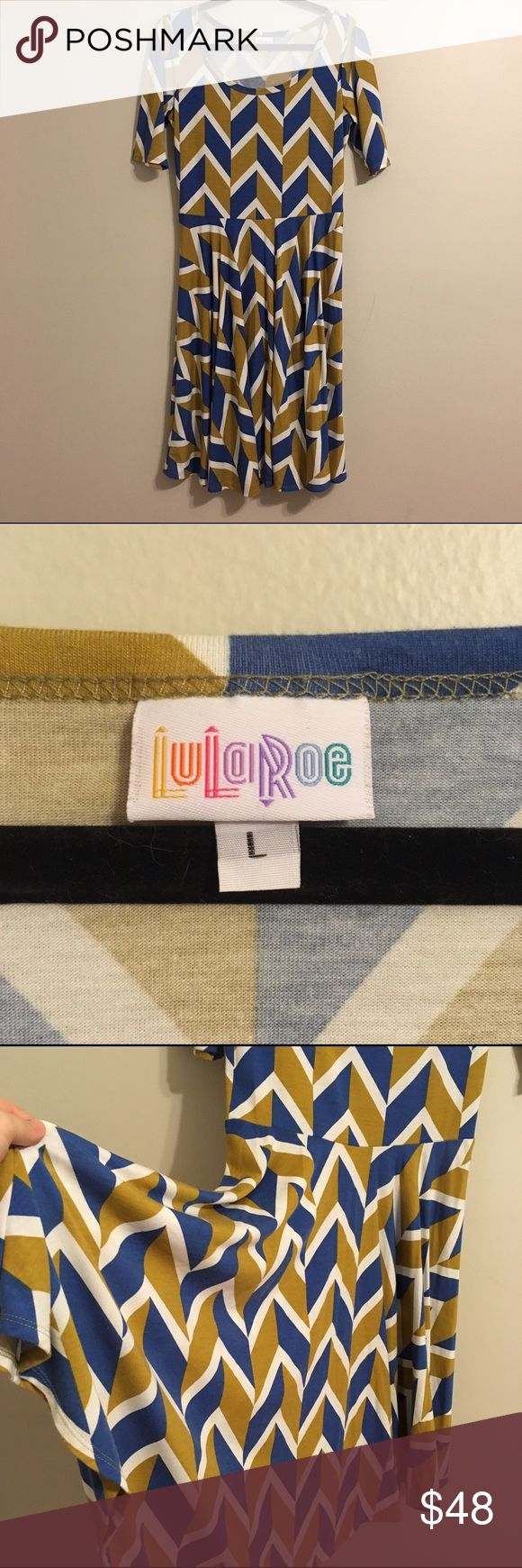 🆕LuLaRoe Yellow & Blue Chevron Nicole LuLaRoe Nicole dress in a fun alternating chevron pattern. Nicole has a full circle skirt. Dress in excellent used condition. Offers welcome, bundles encouraged! LuLaRoe Dresses
