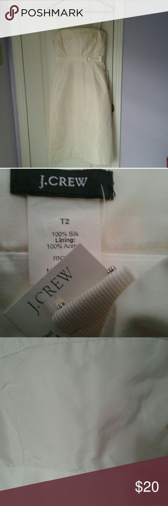 J crew cream bow dress Women's brand new w tags J crew cream bow dress. Size tall 2. T2. Has a tiny little mark, I'm not sure what, pictured 3.   Formal semi formal J. Crew Dresses