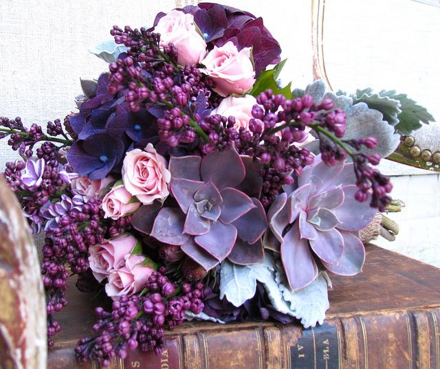 Beautifully Unique Bouquet with succulents, hydrangea, roses, lilac, lambs ear, and another plant I'm unfamiliar with.