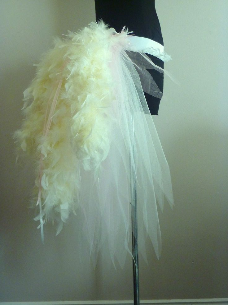 Feather Bustle Belt (this is simply feather boas...) tutu with feathers in the back.