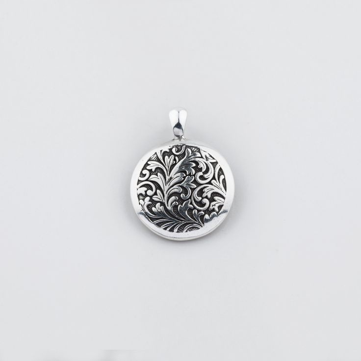 EN1105 #Floral arabesque #pendant in burnished silver with a sleek edge - www.miglio.com