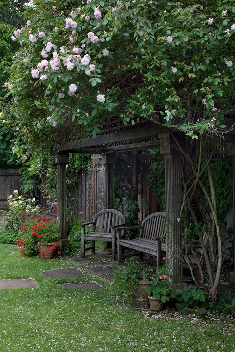 Beautiful, rustic garden nook with rose arbor!