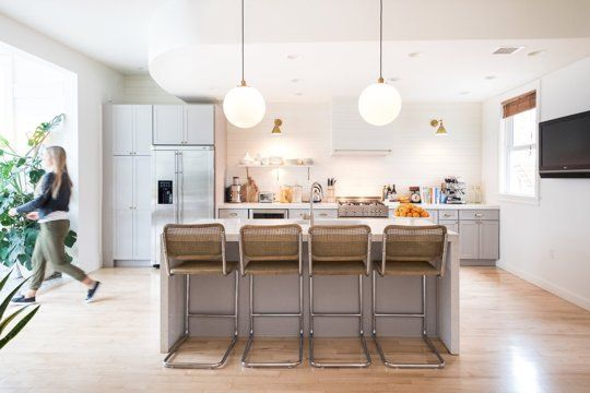 Love the way these globe lights look in this modern kitchen. These are a great option for kitchen lighting.