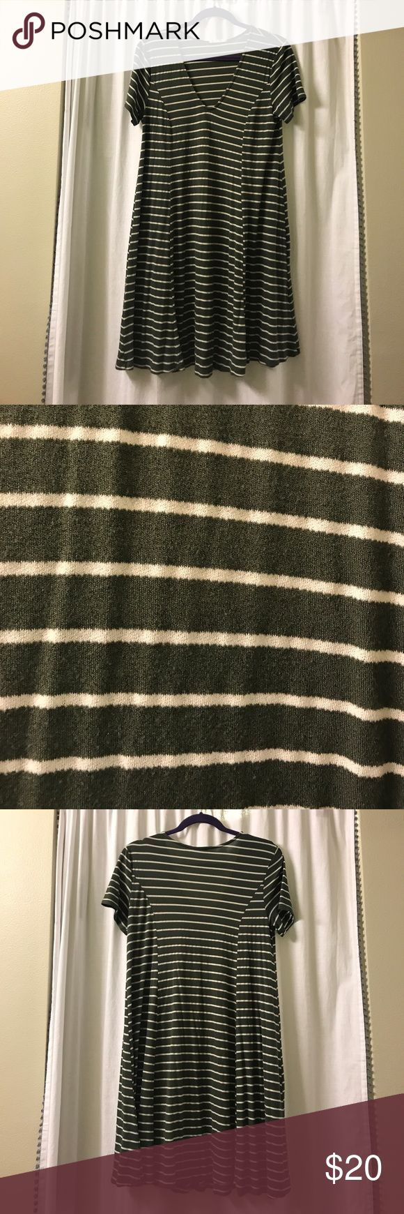 LUSH olive green and white striped trapeze dress LUSH olive green and white striped grapes dress. A great piece alone or with a denim jacket. Make an offer! Lush Dresses Midi