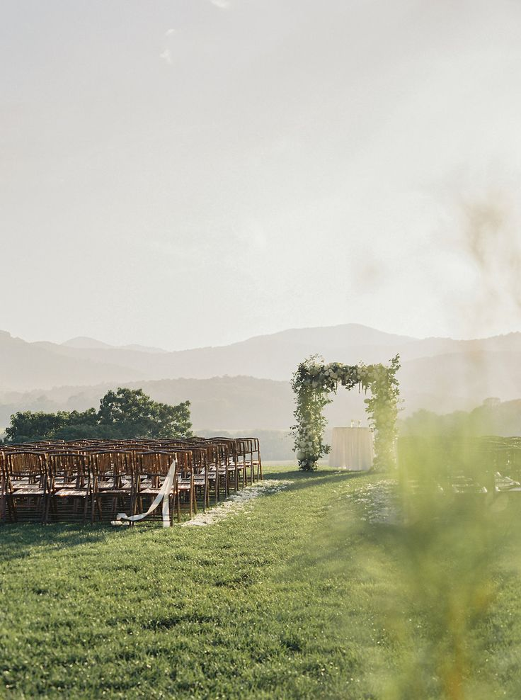 Outdoor wedding ceremony in the mountains at Pippin Hill Farm & Vineyards | Photographer: Laura Gordon