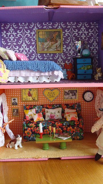 My dollhouse made out of a shoebox is complete! Yay! It is almost 12 inches tall. I think I want to make a special doll to live in this house.