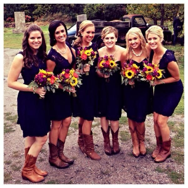 Navy bridesmaids and cowboy boots!!! Soooo cute!!!! I love the lace look at the top of the dresses!!! Very classy. #BeldenWedding2015