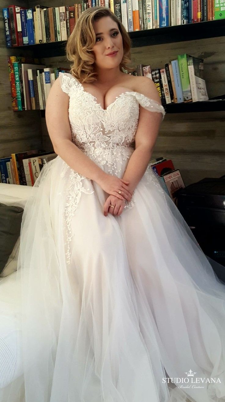 Plus size princess wedding gown with a sheer corset, beaded bodice and gentle tu…